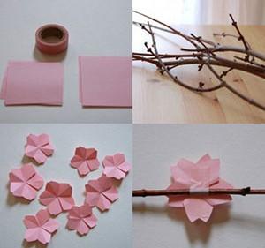 Создание аппликации цветов сакуры из цветной бумаги на ветках